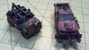 A medium armored jeep and a heavy truck with guns, turbo-boost and a heavy ram